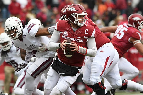 Arkansas quarterback Austin Allen looks to throw a pass during a game against Mississippi State on Saturday, Nov. 18, 2017, in Fayetteville.