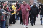 Arkansas coach Bret Bielema is greeted by fans as he enters the stadium to play Mississippi State during an NCAA college football game Saturday, Nov. 18, 2017 in Fayetteville. (AP Photo/Michael Woods)