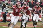 Arkansas defender Briston Guidry (7) celebrates with teammates McTelvin Agim (2) and Kevin Richardson (30) after recovering a fumble in the end zone for a touchdown against Mississippi State during the first half of an NCAA college football game Saturday, Nov. 18, 2017 in Fayetteville. (AP Photo/Michael Woods)