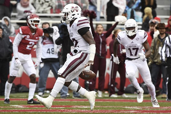 Mississippi State running back Aeris Williams slips through the Arkansas defense to score a touchdown during the first half of an NCAA college football game Saturday, Nov. 18, 2017 in Fayetteville. (AP Photo/Michael Woods)
