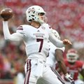 Mississippi State quarterback Nick Fitzgerald drops back to pass in a 28-21 win over Arkansas Saturd...