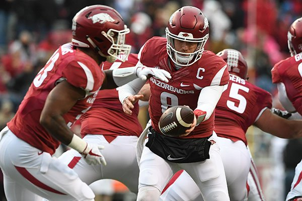 Arkansas quarterback Austin Allen fakes a handoff to running back David Williams during a game against Mississippi State on Saturday, Nov. 18, 2017, in Fayetteville.