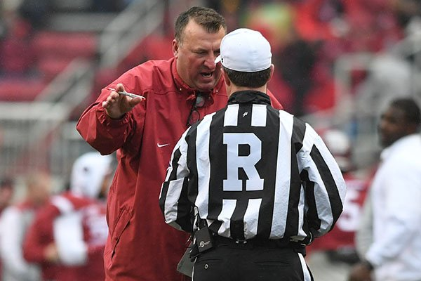 Arkansas coach Bret Bielema argues with official Marc Curles during a game against Mississippi State on Nov. 18, 2017, in Fayetteville.