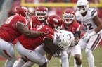 Arkansas defensive lineman McTelvin Agim (3) leads several defenders in tackling Mississippi State receiver Jesse Jackson (86) during a game Saturday, Nov. 18, 2017, in Fayetteville.