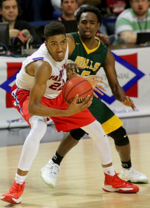 3/9/17 Arkansas Democrat-Gazette/STEPHEN B. THORNTON Parkview's Javon Franklin (22) steals the ball from Mills' Quawn Marshall , background, and is fouled with 15 wish seconds left  during their Class 5A State Championship basketball game Thursday in Hot Springs.