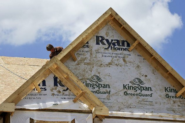 workers-install-a-roof-on-a-home-going-up-earlier-this-year-in-jackson-township-pa-the-rise-in-home-construction-in-october-was-the-biggest-in-a-year