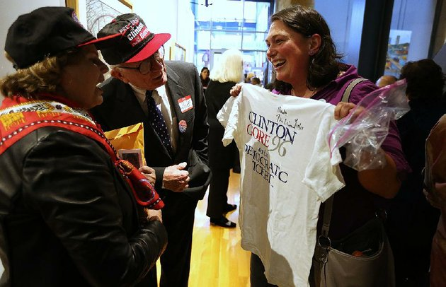 angela-danovi-right-shows-off-her-clinton-gore-96-campaign-t-shirt-to-marian-and-david-hodges-during-fridays-gathering-at-the-butler-center-for-arkansas-studies-in-downtown-little-rock