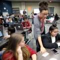 Tamara Thiam, a social studies teacher at the Tyson School of Innovation, hands out assignments Thur...