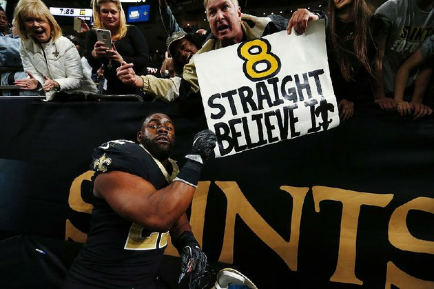 new-orleans-saints-running-back-mark-ingram-celebrates-with-fans-after-the-saints-34-31-overtime-victory-over-the-washington-redskins-on-sunday-the-saints-trailed-by-15-points-with-less-than-3-minutes-remaining-but-rallied-for-their-eighth-consecutive-victory
