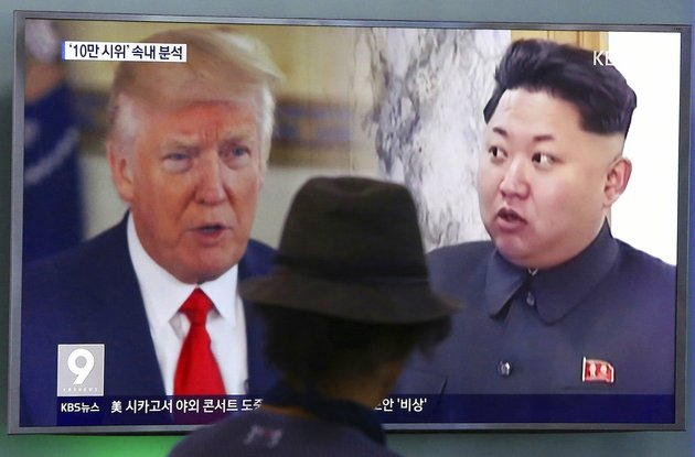 in-this-aug-10-2017-file-photo-a-man-watches-a-tv-screen-showing-us-president-donald-trump-and-north-korean-leader-kim-jong-un-right-during-a-news-program-at-the-seoul-train-station-in-seoul-south-korea