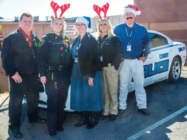 cabot-police-department-capt-brent-lucas-from-left-resource-officer-brittany-tauton-chaplain-tina-frost-dispatch-lead-teresa-young-and-lt-robby-gibson-pose-in-front-of-a-police-car-the-cabot-officers-playing-santa-toy-patrol-or-cops-toy-patrol-is-centered-around-providing-christmas-gifts-to-children-in-need