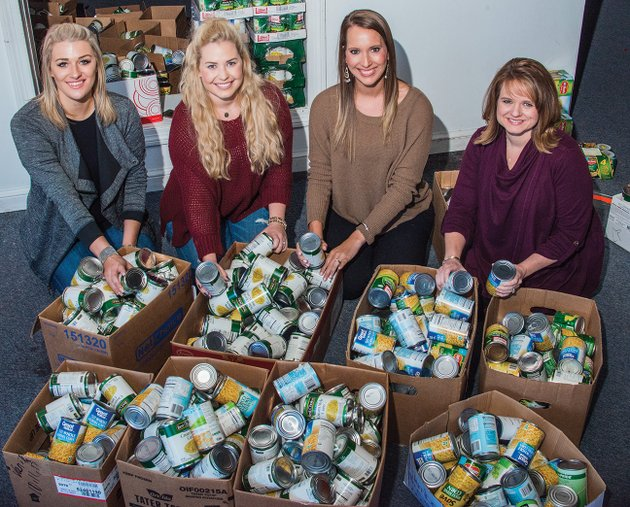 the-junior-auxiliary-of-searcy-sponsored-its-annual-food-basket-project-to-help-local-families-with-their-thanksgiving-meals-helping-to-sort-more-than-2000-canned-food-items-collected-by-students-in-the-searcy-school-district-are-jessie-hohenstein-of-searcy-from-left-co-chairwoman-of-the-angel-tree-project-and-chairwoman-of-the-sunshine-school-project-and-the-covering-kids-project-ashley-fulks-of-searcy-chairwoman-of-the-food-basket-project-and-pubic-relations-chairwoman-for-the-organization-morgan-george-of-searcy-treasurer-and-natalie-horton-of-searcy-president