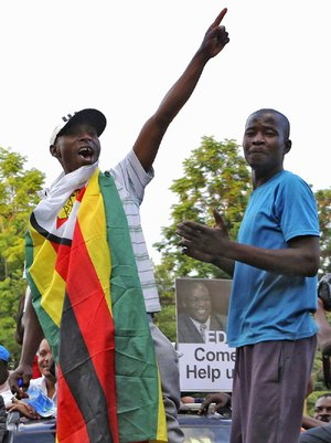 Zimbabweans celebrate Tuesday in Harare at news of President Robert Mugabe's resignation.