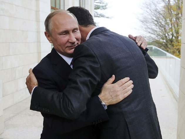 russian-president-vladimir-putin-left-gets-an-embrace-monday-from-syrian-president-bashar-assad-at-the-black-sea-resort-town-of-sochi-russia-after-talks-about-a-new-peace-initiative-drafted-by-russia-turkey-and-iran-putin-and-president-donald-trump-later-discussed-the-plan-in-an-hour-plus-phone-call