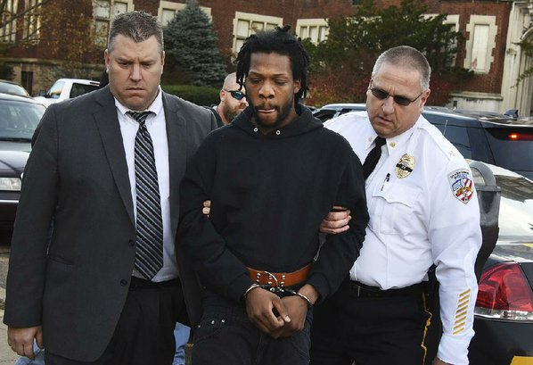 Police arrest man sought in killing of Pa. police officer