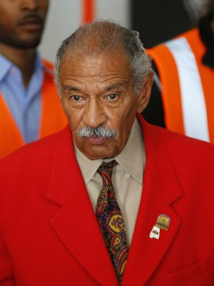 In this July 7, 2014 file photo, U.S. Rep. John Conyers, D-Mich., speaks in Detroit. The longtime Michigan Congressman on Tuesday, Nov. 21, 2017, denied settling a sexual harassment complaint in 2015 from a woman who alleged she was fired from his Washington staff because she rejected his sexual advances.