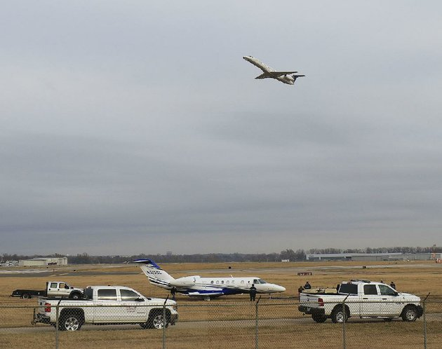 a-cessna-citation-cj4-jet-is-prepared-to-be-towed-tuesday-morning-at-bill-and-hillary-clinton-national-airportadams-field-after-it-ran-off-the-runway-late-monday-night