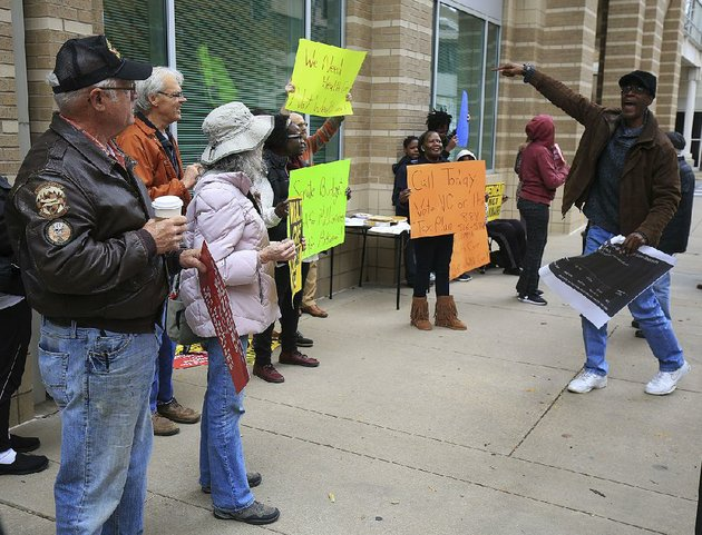 tony-orr-right-of-little-rock-leads-a-chant-tuesday-as-a-group-of-people-rally-near-the-state-department-of-human-services-offices-on-main-street-in-little-rock-to-oppose-a-gop-proposed-tax-overhaul-in-congress