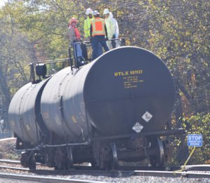 Photo by Mike Eckels A Kansas City Southern maintenance crew works on a tank car that was parked on a siding near the depot in Decatur Nov. 9. It was not clear the nature of the work on this and on a second car, behind it.