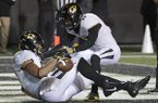 Missouri tight end Albert Okwuegbunam, left, celebrates with wide receiver Richaud Floyd (17) after Okwuegbunam scored a touchdown on a 57-yard pass against Vanderbilt in the second half of an NCAA college football game Saturday, Nov. 18, 2017, in Nashville, Tenn. (AP Photo/Mark Humphrey)