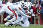 Alabama quarterback Jalen Hurts is tackled during the first half of the Iron Bowl NCAA college football game, Saturday, Nov. 26, 2016, in Tuscaloosa, Ala. (AP Photo/Brynn Anderson)