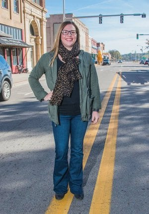"""Morgan Zimmerman stands in downtown Morrilton. She was named Morrilton Citizen of the Year by the Morrilton Area Chamber of Commerce and is active with the chamber, the Century League and Main Street Morrilton. Sarah Croswell, executive director of Main Street Morrilton, said Zimmerman is the head of the Promotions Committee, and """"she does lots behind the scenes that nobody would ever know."""""""