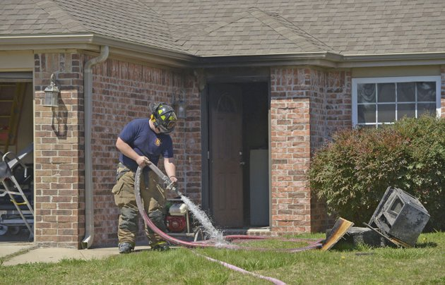 centerton-firefighters-put-away-their-equipment-april-7-after-working-a-house-fire-in-centerton-the-fire-began-in-the-kitchen-where-the-resident-was-cooking-causing-extensive-damage-fire-departments-gets-slightly-more-kitchen-and-cooking-related-calls-during-the-holidays-said-thomas-good-assistant-chief-with-the-fayetteville-fire-department-good-said-one-of-the-most-common-causes-of-house-fires-he-sees-is-food-left-cooking-unattended