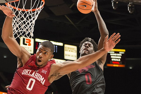 oklahoma-guard-christian-james-left-is-fouled-by-arkansas-guard-jaylen-barford-right-on-a-fast-break-during-the-first-half-of-an-ncaa-college-basketball-game-at-the-phil-knight-invitational-tournament-in-portland-ore-thursday-nov-23-2017-ap-phototroy-wayrynen