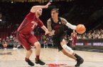 Arkansas forward Dustin Thomas, right, drives to the basket as he is guarded by Oklahoma forward Matt Freeman, left, during the second half in an NCAA college basketball game at the Phil Knight Invitational tournament in Portland, Ore., Thursday Nov. 23, 2017. (AP Photo/Troy Wayrynen)