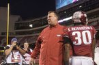Arkansas coach Bret Bielema greets players as they walk off the field following a 48-45 loss to Missouri on Friday, Nov. 24, 2017, in Fayetteville. Bielema was fired following the game.
