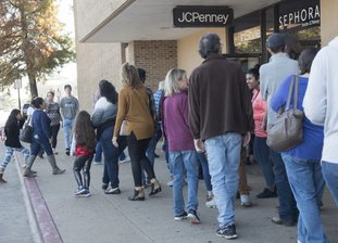 The Associated Press LINED UP: Shoppers wrap around the building as JC Penney and Sephora at Broadway Square Mall in Tyler, Texas, open their doors on Thanksgiving Day. Shoppers hitting the stores on Thanksgiving will be finding some surprises: toys and TVs at J.C. Penney, Barbies at Best Buy, kitchen appliances like wine refrigerators at B.J.'s.