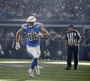 The Associated Press ROOM TO RUN: Los Angeles Chargers' tight end Hunter Henry (Pulaski Academy, University of Arkansas) gains long yardage after catching a pass in the first half of an NFL football game against the Dallas Cowboys on Thursday in Arlington, Texas. Henry had five catches for 76 yards and a touchdown in the Chargers' 28-6 win.