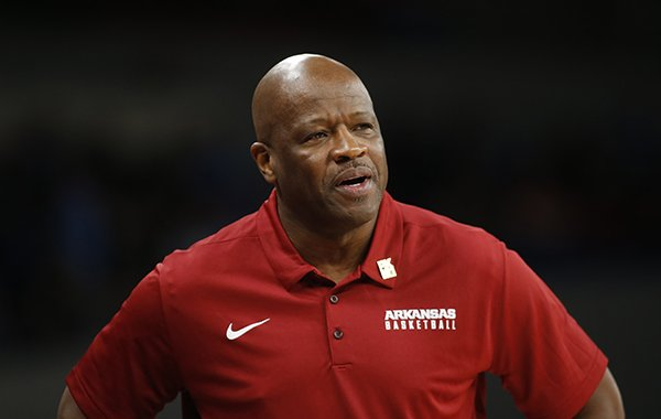 Arkansas head coach Mike Anderson watches the action in the first half of an NCAA college basketball game during the Phil Knight Invitational tournament in Portland, Ore., Friday, Nov. 24, 2017. (AP Photo/Timothy J. Gonzalez)