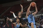 North Carolina's Luke Maye (32) gets past Arkansas' Trey Thompson (1) and Dustin Thomas, center rear, and teammate Garrison Brooks, center, for two points in the first half of an NCAA college basketball game during the Phil Knight Invitational tournament in Portland, Ore., Friday, Nov. 24, 2017. (AP Photo/Timothy J. Gonzalez)