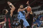 North Carolina's Joel Berry II (2) drives to the basket past Arkansas' Daniel Gafford (10) and Anton Beard (31) in the second half of an NCAA college basketball game during the Phil Knight Invitational tournament in Portland, Ore., Friday, Nov. 24, 2017. (AP Photo/Timothy J. Gonzalez)