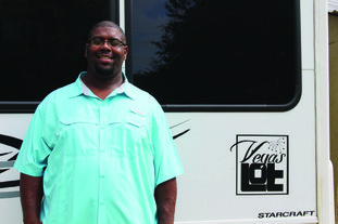 Party Bus: Electrical engineer Merari Davis shows off his party bus project with a logo for The Vegas Lot, a rental space near the West Hillsboro-North West intersection. Brittany Williams/News-Times