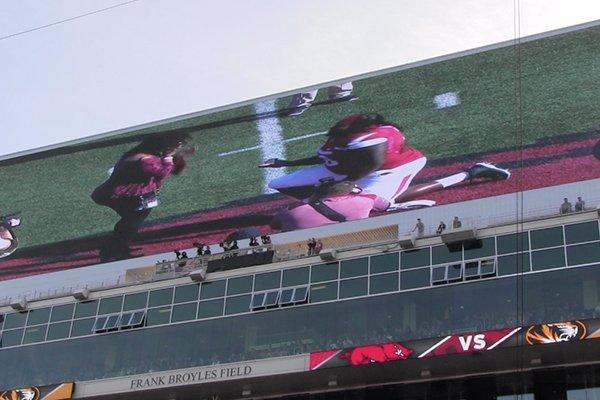 Arkansas defnesive lineman Bijhon Jackson proposes to his girlfriend during Senior Day ceremonies prior to a game against Missouri on Friday, Nov. 24, 2017, in Fayetteville.