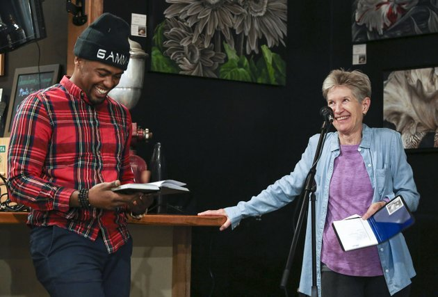 karen-hayes-jokes-with-gamma-a-poet-from-little-rock-while-introducing-him-to-the-crowd-during-open-mic-night-at-guillermos-coffee-tea-and-roastery-in-little-rock-on-nov-9-hayes-gained-a-newfound-love-of-poetry-after-her-husband-was-diagnosed-with-alzheimers-several-years-ago