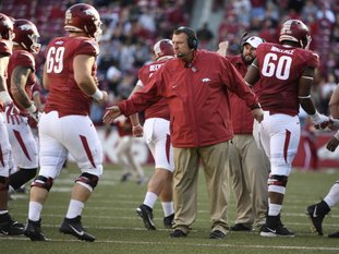 The Associated Press BIELEMA GONE: Arkansas coach Bret Bielema, center, talks to his team following their 48-45 loss to Missouri Friday in Fayetteville.