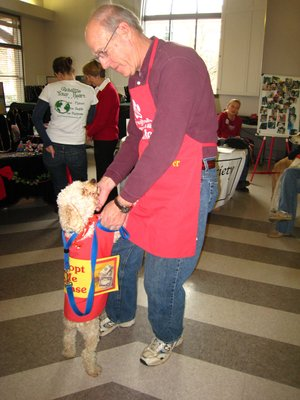 Courtesy Photo Melissa Swann, Alternative Gift Market coordinator, says that organizations like the Humane Society of the Ozarks and the Fayetteville Animal Shelter often bring dogs and cats who are looking for permanent homes to the event.
