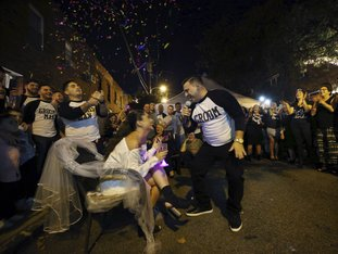 The Associated Press WEDDING SERENADE: As friends and family react, bride-to-be, Stephanie Longo sits in a chair on the street in front of her family's home, as her groom Paolo DiPaolo sings, during a modern version of a centuries- old traditional Italian wedding serenade, Saturday, Oct. 7, 2017, in Philadelphia, Pa. The Italian wedding serenades came along with immigrants to Philadelphia in the 1800s and retained their modest flavor until recent years. Now, the serenade has taken on an air of a block party, with grooms singing to a choreographed routine with popular songs as guests enjoy a catered meal, full bar and DJ dance party.