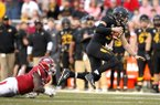 Missouri quarterback Drew Lock is tackled by Arkansas linebacker De'Jon Harris during a game Friday, Nov. 24, 2017, in Fayetteville.
