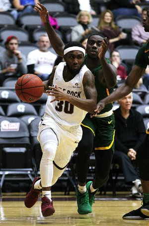 UALR's Anthony Black (30) drives to the basket past Norfolk State's Mastadi Pitt during the first half of UALR's 70-55 victory Sunday at the Jack Stephens Center in Little Rock. Black had five points for the Trojans.