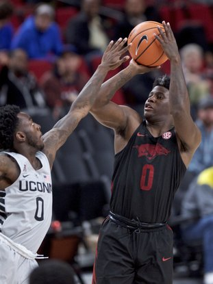 The Associated Press BARFORD'S HOT HAND: Arkansas guard Jaylen Barford, right, shoots over Connecticut guard Antwoine Anderson during the second half of an NCAA basketball game in the Phil Knight Invitational tournament in Portland, Ore., Sunday. Barford led Arkansas with 24 as the Razorbacks rolled over the Huskies, 102-67.