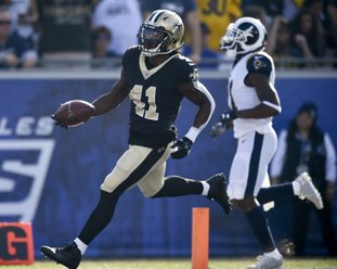 The Associated Press BIG RUN ROOKIE: New Orleans Saints running back Alvin Kamara runs for a 74-yard touchdown against the Los Angeles Rams during the first half of an NFL game Sunday in Los Angeles. Kamara finished with six carried for 101 yards.