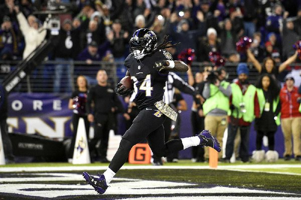 Baltimore Ravens running back Alex Collins scores a touchdown in the first half of an NFL football game against the Houston Texans, Monday, Nov. 27, 2017, in Baltimore. (AP Photo/Nick Wass)