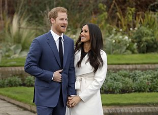 The Associated Press ROYAL ENGAGEMENT: Britain's Prince Harry and his fiancee Meghan Markle pose for photographers during a photocall in the grounds of Kensington Palace Monday in London. Britain's royal palace says Prince Harry and actress Meghan Markle are engaged and will marry in the spring of 2018.