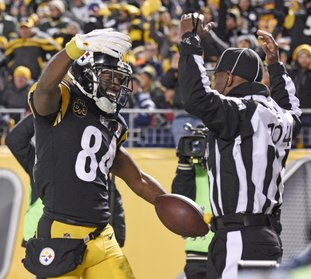 The Associated Press BROWN DELIVERS: Pittsburgh Steelers wide receiver Antonio Brown (84) celebrates his touchdown catch in front of field judge Dale Shaw (104) during the second half of an NFL game against the Green Bay Packers in Pittsburgh, Sunday.