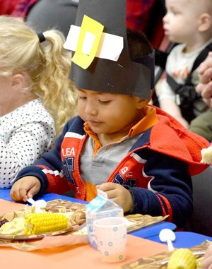 Photo by Mike Eckels Wearing a paper pilgrim buckle hat, Cesar Suarez chowed down on a traditional holiday feast during the Thanksgiving celebration in the classroom of Joyce Turnage at Decatur Pre-K School in Decatur Nov. 21.