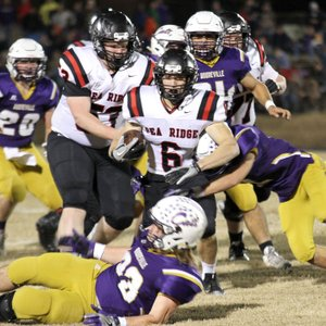 Photograph courtesy of Stephanie Harwell Blackhawk senior Drew Winn (No. 6) led the Blackhawk offense Friday night in the 4A state playoff semifinal game against Booneville gaining 167 yards on 33 carries, surpassing his elder brother's yardage record.